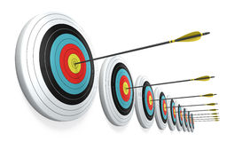 Arrows hitting the center of targets Stock Photo