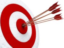 Arrows hitting directly in bulls eye Royalty Free Stock Image