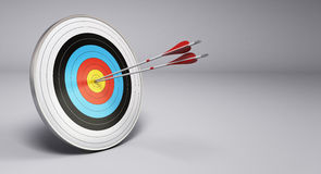 Arrows Hitting Target, Archery. Two arrows hitting the center of a target, grey background. 3D render illustration Stock Photos