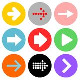 Arrows icons. Vector illustration set of nine different type of arrows in rounded colorful buttons for the web. Isolated on white background Royalty Free Stock Images