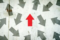 Free Arrows In Different Directions On A Concrete Wall. Red Arrow, Right Direction. Leadership Concept. Team. Business Royalty Free Stock Photos - 216399338