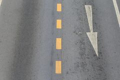 The arrows indicate the direction of traffic. Stock Images