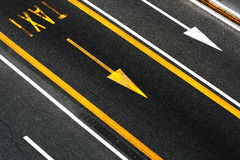 Arrows and lines with taxi caption. City asphalt road floor with white and yellow lines, arrows and taxi caption stock photography