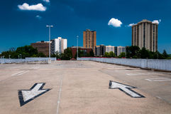 Arrows in parking lot and view of highrises from a parking garage Royalty Free Stock Photography