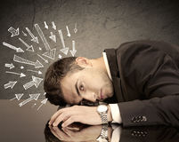 Arrows pointing at sad office worker Royalty Free Stock Image
