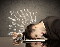 Arrows pointing at sad office worker Stock Photo
