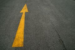 Arrows, the road. Yellow arrows on the road Stock Image