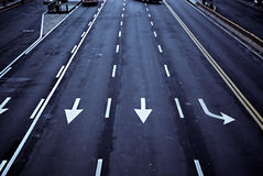 Arrows on the road. A picture of an empty five-lane road, with arrows indicating the direction of each lane stock image