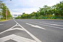 Arrows on the road. A picture of an empty road, with arrows indicating the direction of each lane Stock Photo