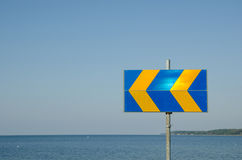 Arrows roadsign by the coast Stock Images