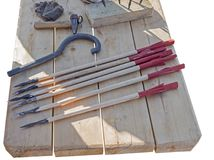 Arrows for Roman crossbow. On a wooden table Royalty Free Stock Image