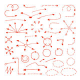 Arrows. Set of hand drawn arrows, circles, dash line elements. Sketch arrows pointing in different directions. Red signs isolated on white background Royalty Free Stock Images