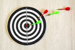Arrows on target dart on wooden background. Top view. Stock Image