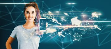 Arrows with young woman holding out a smartphone Royalty Free Stock Images