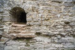 Arrowslit and limestone castle wall stock photo