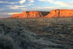 Arroyo und Buttes-Sonnenuntergang Stockbild
