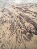 Arroyo y marcas de marea en la playa Imagen de archivo libre de regalías
