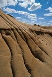 Arroyuelos de la erosión en los badlands Foto de archivo