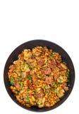 Arroz com carne, vegetais e cogumelos em uma frigideira Vista superior Isolado Fotos de Stock