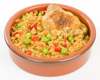 Arroz Con Pollo. Chicken and rice cooked with sofrito and beer Stock Image