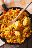 Arroz con pollo close up in a frying pan vertical top view Stock Images