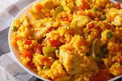 Arroz con pollo - rice with chicken and vegetables closeup. hori. Arroz con pollo - rice with chicken and vegetables close up in a dish. horizontal Stock Images