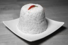 Arroz cozinhado com um pimentão vermelho Imagem de Stock