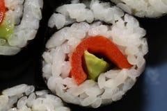 Arroz del rollo de Maki Sushi con las pimientas rojas y el aguacate Foto de archivo