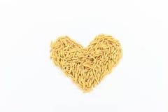 Arroz do jasmim arranjado como uma forma do coração imagem de stock royalty free