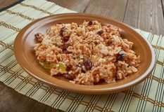 Arroz empedrado. Con Bacalao -  Spanish Rice with cod and beans of Valencia Stock Photos