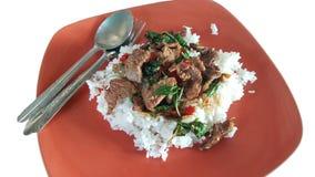 Arroz frito de la albahaca con la comida tailandesa del pollo Fotografía de archivo libre de regalías