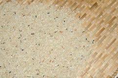 arroz Mitad-pulido en cesta Foto de archivo libre de regalías