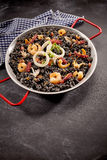 Arroz negro in pan on dark table Royalty Free Stock Photos