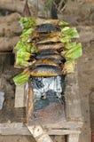 Arroz pegajoso asado a la parrilla envuelto en hojas del pl?tano Fotografía de archivo
