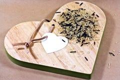 Arroz salvaje en tarjeta del corazón Imagen de archivo libre de regalías