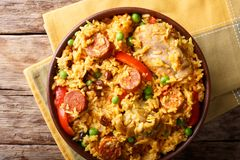 Arroz Valenciana with rabbit, chorizo, vegetables and spices in. A bowl on the table. horizontal top view from above Royalty Free Stock Photography