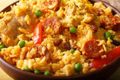 Arroz Valenciana with rabbit, chorizo, vegetables and spices mac. Ro in a bowl on the table. horizontal Royalty Free Stock Photos