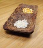 Arroz y maíz en un tazón de fuente Fotografía de archivo libre de regalías