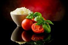 Arroz y tomates Imágenes de archivo libres de regalías