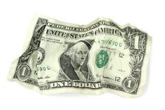 Arrugado un billete de banco del dólar en el fondo blanco Foto de archivo