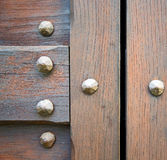 Arsago  bstract   rusty   wood italy  lombardy. Arsago seprio abstract   rusty brass brown knocker in a  door curch  closed wood italy  lombardy Stock Photo