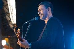 Arsen Mirzoyan, Ukrainian singer, live concert in Pobuzke, Ukraine, 15.07.2017, side view editorial photo. Arsen Mirzoyan plays guitar and smiles to audience royalty free stock photos