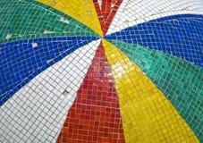 Arsenal de tejas coloreadas con la falta de los pedazos Imagenes de archivo