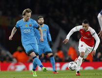 Arsenal FC v FC Barcelona - UEFA Champions League Round of 16: First Leg. LONDON, ENGLAND - FEBRUARY 23: Ivan Rakitic of Barcelona and Francis Coquelin of stock image