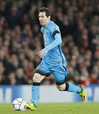 Arsenal FC v FC Barcelona - UEFA Champions League Round of 16: First Leg. LONDON, ENGLAND - FEBRUARY 23: Lionel Messi of Barcelona runs with the ball during the stock image