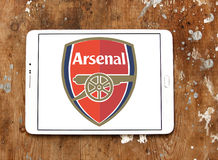 Arsenal football club logo. Logo of english football club arsenal on samsung tablet on wooden background royalty free stock photos