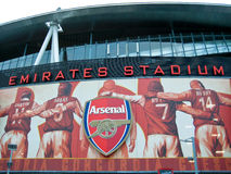 Arsenal Football Legends, Stadium of Light. Image of Arsenal legends over the entrance to the Emirates Stadium of Light. Arsenal logo and canon royalty free stock photography