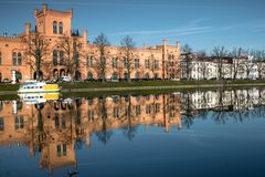 Arsenal in Schwerin. Today the arsenal of Schwerin, in cleric`s pond, accommodates the Department of the Interior of Mecklenburg-West royalty free stock photos