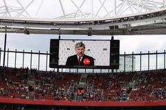 Arsene Wenger on the screen stock image