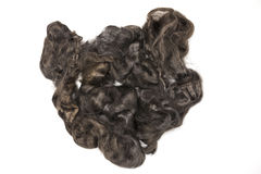 Arsenic gray piece of Australian sheep wool Merino breed close-up on a white background Royalty Free Stock Image